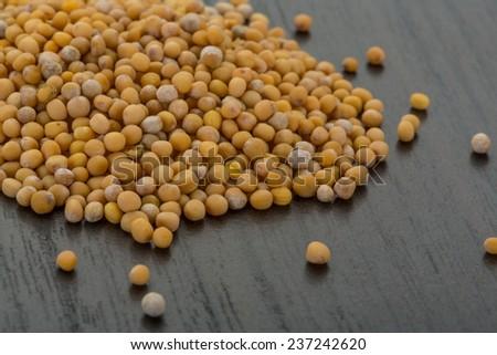 Mustard seeds on the desk - stock photo