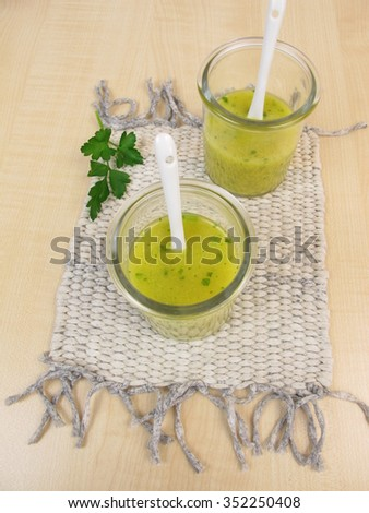 Mustard soup in glass