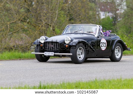 MUTSCHELLEN, SWITZERLAND-APRIL 29: Vintage car MG Midget Arkley from 1964 at Grand Prix in Mutschellen, SUI on April 29, 2012.  Invited were vintage sports cars and motorbikes.