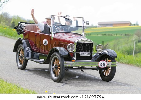 MUTSCHELLEN, SWITZERLAND-APRIL 29: Vintage pre war race car Ford T Tourer from  1926 at Grand Prix in Mutschellen, SUI on April 29, 2012.  Invited were vintage sports cars and motorbikes. - stock photo