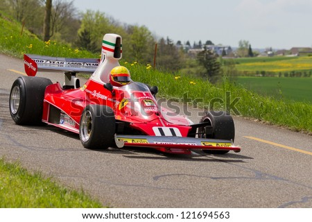 MUTSCHELLEN, SWITZERLAND-APRIL 29: Vintage race car Ferrari 312T from 1975 at Grand Prix in Mutschellen, SUI on April 29, 2012.  Invited were vintage sports cars and motorbikes.