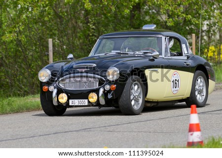 MUTSCHELLEN, SWITZERLAND-APRIL 29: Vintage race touring car Austin Healey 3000 MK III from 1966 at Grand Prix in Mutschellen, SUI on April 29, 2012.  Invited were vintage sports cars and motorbikes.