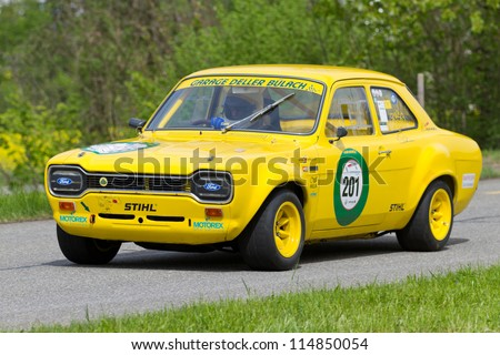 MUTSCHELLEN, SWITZERLAND-APRIL 29: Vintage race touring car Ford Escort TC from 1968 at Grand Prix in Mutschellen, SUI on April 29, 2012.  Invited were vintage sports cars and motorbikes. - stock photo