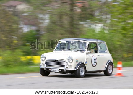 MUTSCHELLEN, SWITZERLAND-APRIL 29: Vintage race touring car Morris Mini Cooper S from 1969 at Grand Prix in Mutschellen, SUI on April 29, 2012.  Invited were vintage sports cars and motorbikes. - stock photo