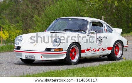 MUTSCHELLEN, SWITZERLAND-APRIL 29: Vintage race touring car Porsche Carrera RS 2.7 from 1973 at Grand Prix in Mutschellen, SUI on April 29, 2012.  Invited were vintage sports cars and motorbikes.