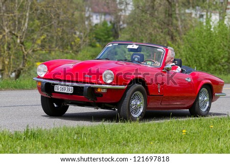 MUTSCHELLEN, SWITZERLAND-APRIL 29: Vintage race touring car Triumph Spitfire GT6 MK III from 1971 at Grand Prix in Mutschellen, SUI on April 29, 2012.  Invited were vintage sports cars and motorbikes.