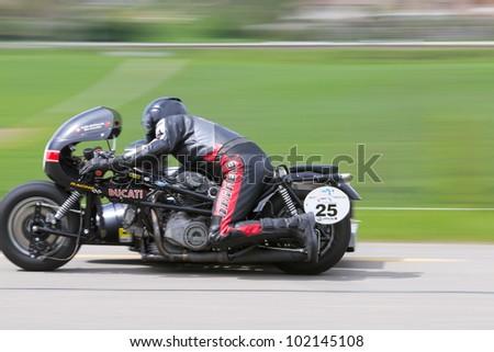 MUTSCHELLEN, SWITZERLAND-APRIL 29: Vintage sidecar motorbike Ducati Kneeler  from 1975 at Grand Prix in Mutschellen, SUI on April 29, 2012.  Invited were vintage sports cars and motorbikes. - stock photo