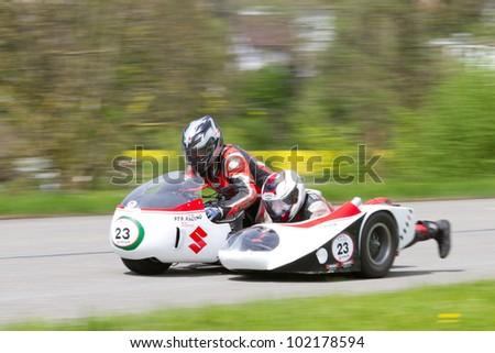 MUTSCHELLEN, SWITZERLAND-APRIL 29: Vintage sidecar motorbike STR Suzuki Kneeler T 500  from 1979 at Grand Prix in Mutschellen, SUI on April 29, 2012.  Invited were vintage sports cars and motorbikes. - stock photo