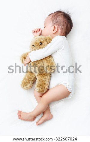 My Best Friend, Baby sleeping with her teddy bear (Soft focus and blurry)