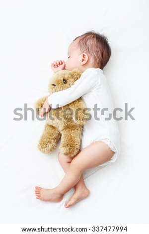 My Best Friend, Baby sleeping with her teddy bear (Soft focus and blurry) - stock photo