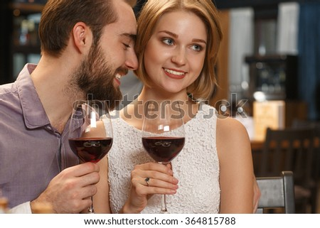 My best gift. Portrait of a beautiful young couple enjoying dinner and wine together at the restaurant
