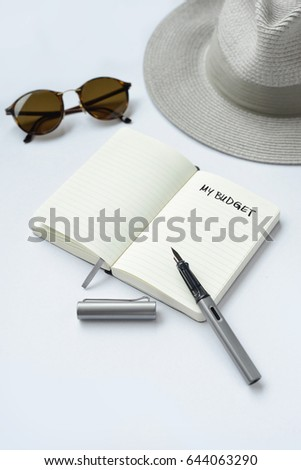 My budget, written on a notebook - taken in natural light with strong shadow to create realistic indoor mood
