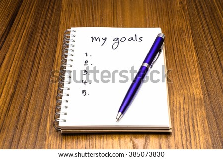My Goals in notebook on wood background