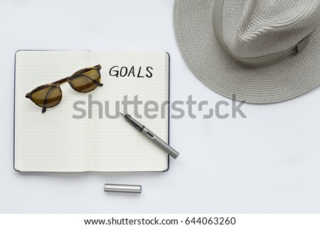 My goals, written on a notebook - taken in natural light with strong shadow to create realistic indoor mood