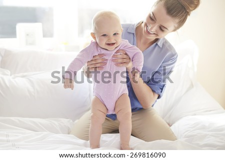 My little girl takes first steps  - stock photo