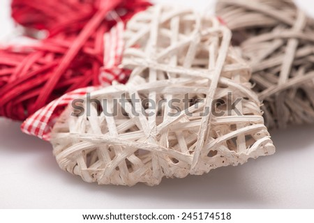 My love is everlasting. Closeup image of lovely decorative colored hearts with ribbon beautifully arranged on white background - stock photo