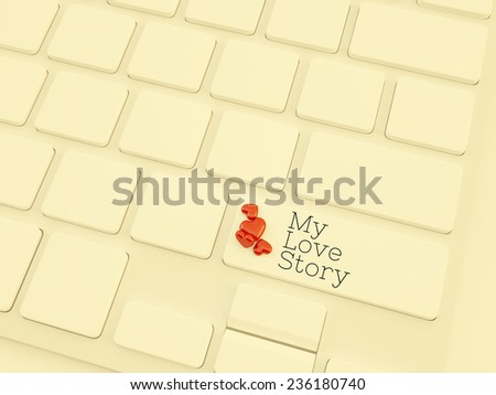 my love story key on keyboard with small heart shape object  - stock photo