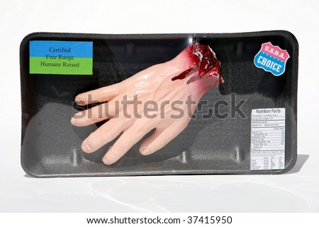 My original artwork,  plastic dismembered hand in a butchers wrap for a halloween prop - stock photo
