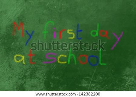 my 1st day at school with colored chalk on a black board - stock photo
