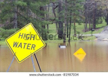 My street is closed off by flood waters,heavy rain for a week has pushed rivers over their banks & flood many homes and businesses - stock photo