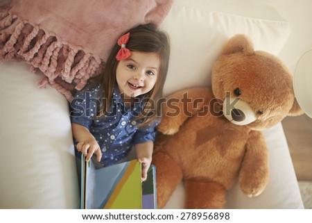 My teddy bear loves a storytelling - stock photo