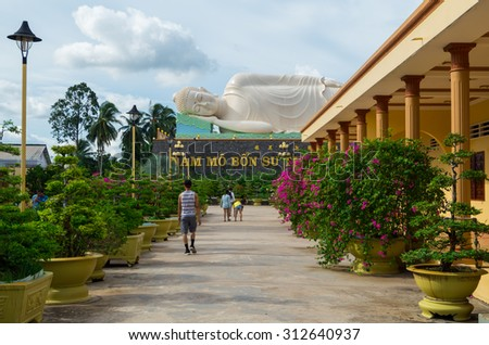 My Tho, Vietnam - August 11, 2015: Large reclining Buddha statue in Vinh Trang Temple, a 19th century Buddhist temple in My Tho in the province of Tien Giang.