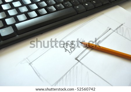 My web site design brainstorm process on my office work table. How to create good web page design? My way is to sketch on general concept first. You can see also a little simple elephant logo there. - stock photo