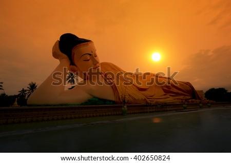 Mya Tha Lyaung Reclining Buddha  in the sunset. Bago, Myanmar. - stock photo
