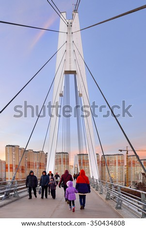 MYAKININO, RUSSIA - DEC 11,2015:Pedestrian bridge is built from two pylons, each measuring 41 m tall. Pylons are connected to spans with help of 28 straight cable wires, which hold up suspension spans - stock photo