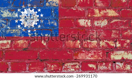 Myanmar flag painted on old brick wall texture background - stock photo