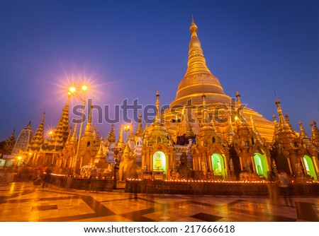 Myanmer famous sacred place and tourist attraction landmark - Shwedagon Paya pagoda illuminated in the evening. Yangon, Myanmar (Burma) - stock photo