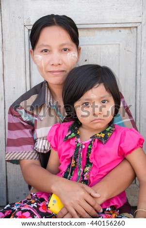 Myawaddy, Karen State, Myanmar  - May 05 , 2015 : Unidentified   mother and her daughter at Golden Pagoda   Myawaddy, Karen State, Myanmar