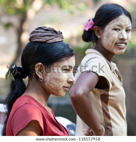 MYITKYINA, MYANMAR - JANUARY 04: An unidentified Burmese women with thanaka paste on the face posing for the photo during the Manaw Festival on January 04, 2012 in Myitkyina, Myanmar