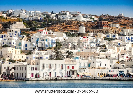 MYKONOS, GREECE - SEPTEMBER 20, 2011: Village scene, with local businesses, windmills, visitors, in Mykonos Island, Greece