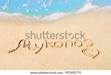 Mykonos - the inscription on the sand - the most popular island in Greece with the best beaches - stock photo