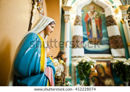 Mykykyntsi, Ukraine - circa June, 2016: Close up of plaster figure of Jesus Christ and Holy Mary at church - stock photo