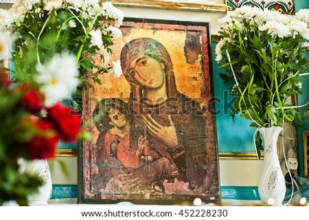 Mykykyntsi, Ukraine - circa June, 2016: Old wooden image icon of the Mother of God Mary and child Jesus Christ at church - stock photo