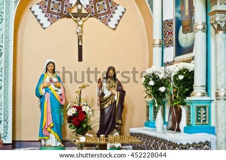 Mykykyntsi, Ukraine - circa June, 2016: Plaster figure of Jesus Christ and Holy Mary at church - stock photo