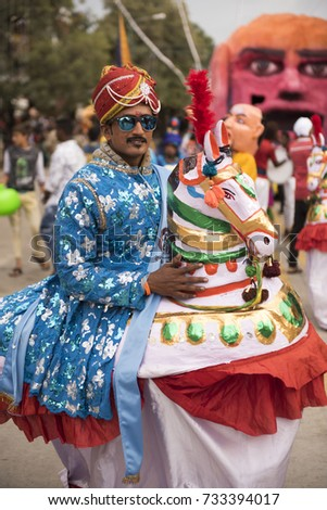 Mysore / India 30 September 2017 Horse man traditional entertainer performing folk dance drama  on street during Mysore Dasara festivities at  Mysore ( Mysuru) in Karnataka India