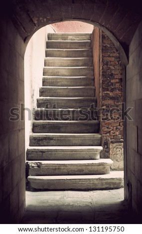 Mysterious ancient empty staircase in sepia - stock photo