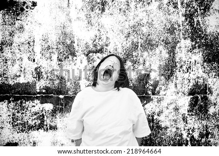 Mysterious and crazy girl screaming, excitement and fear - stock photo