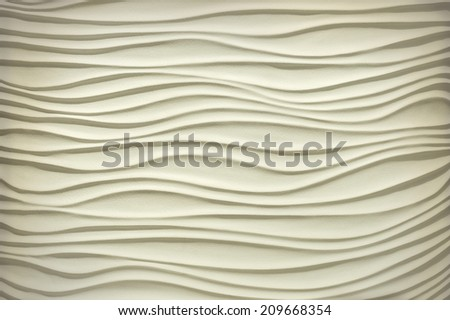 Mysterious beige texture in form of sandy dunes with soft side lighting - stock photo