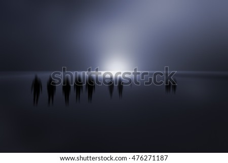 Mysterious blurred people walking in a dark blue background