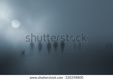 Mysterious blurred people walking in the fog - stock photo