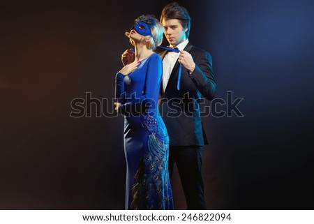Mysterious carnival mask couple - stock photo