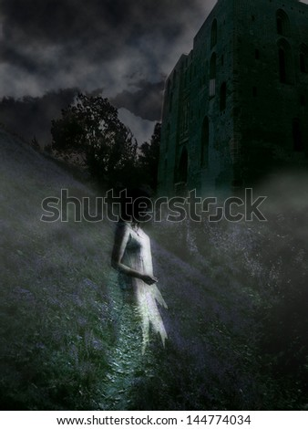 Mysterious castle with a ghost at night in the fog - stock photo