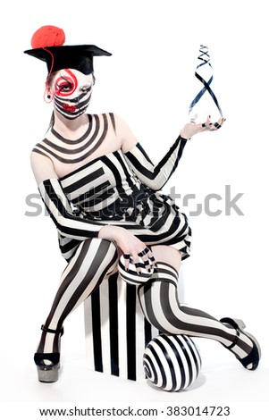 mysterious circus clown in Masquerade costume with creative make up