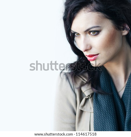 mysterious face of beautiful young woman - stock photo