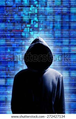 mysterious hacker in hood with code data background - stock photo