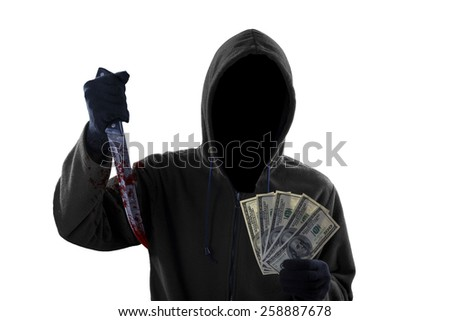 Mysterious mugger wearing black hoodie while holding a bloody knife and money dollar - stock photo
